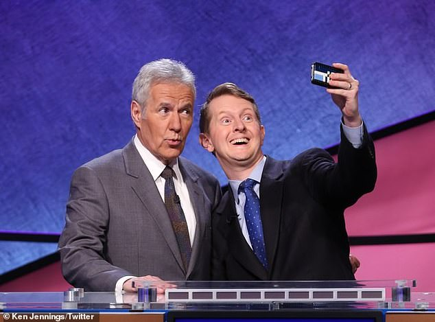 Temporary: The 47-year-old trivia master (R) - who once won Jeopardy 74 consecutive times - will only be shooting a 'few weeks worth of episodes' due to past controversial tweets(pictured with the late Alex Trebek)