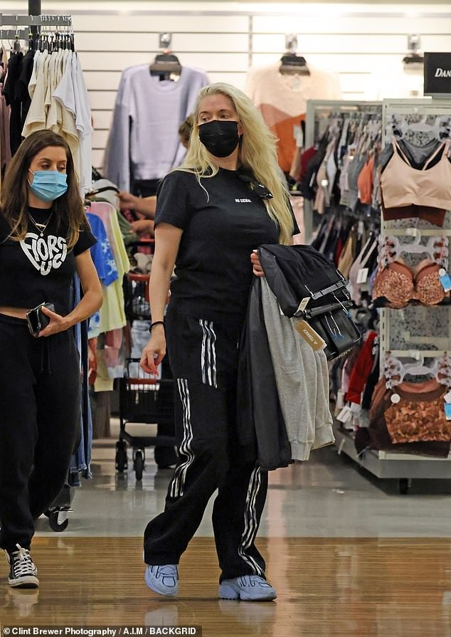 Browsing:The 50-year-old RHOBH star was completely devoid of makeup and opted for a simple T-shirt and sweatpants as she browsed the aisles for low-priced items with her assistant