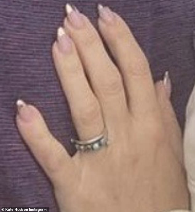 New ring: The star proudly flashed her new non-traditional engagement band