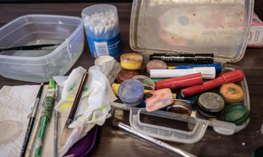 Face paints on a table backstage during a performance.