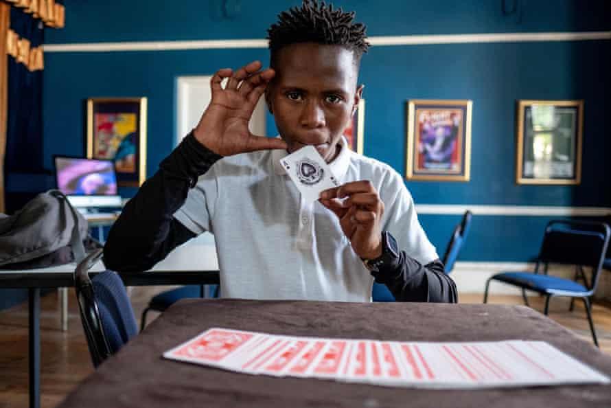 Duma Mgqoki practices a card trick.