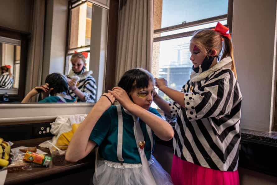 College of Magic students Emilie van den Hooyen and Maelle Oudejans help each other get ready for a performance at the Artscape theatre centre.
