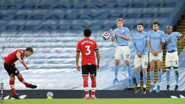 James Ward-Prowse takes a free-kick against Manchester City