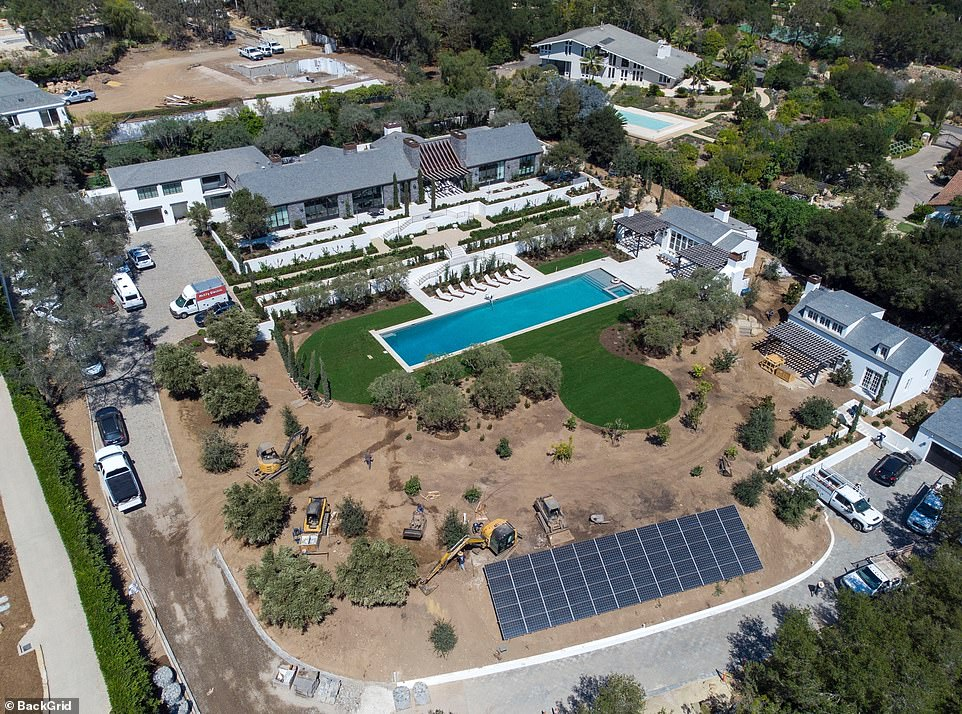 60 solar panels! Aerial images taken Thursday of their two-acre estate reveal their buildings and Olympic-size pool are complete and surrounded by fresh grass and more trees since July 14