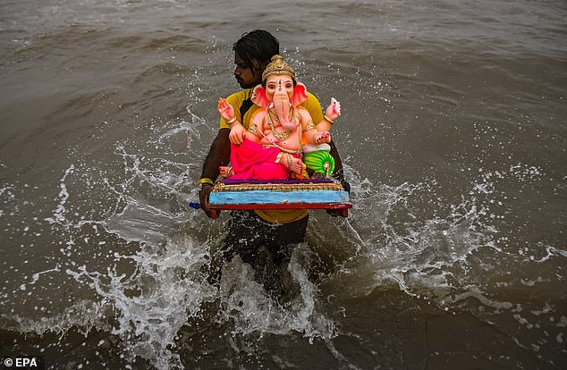 On the tenth day of Ganesh Chaturthi, idols of the elephant-headed deity are immersed in a nearby river or sea