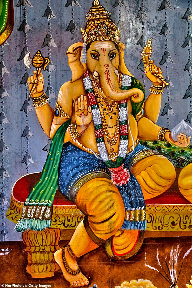 Ganesh is typically presented with four arms, with an ax in his upper right hand, a noose in his upper left hand and sweet dumplings in the lower left. His broken tusk is often shown his lower right though sometimes the hand is extended out to the viewer in a posture of enlightenment.