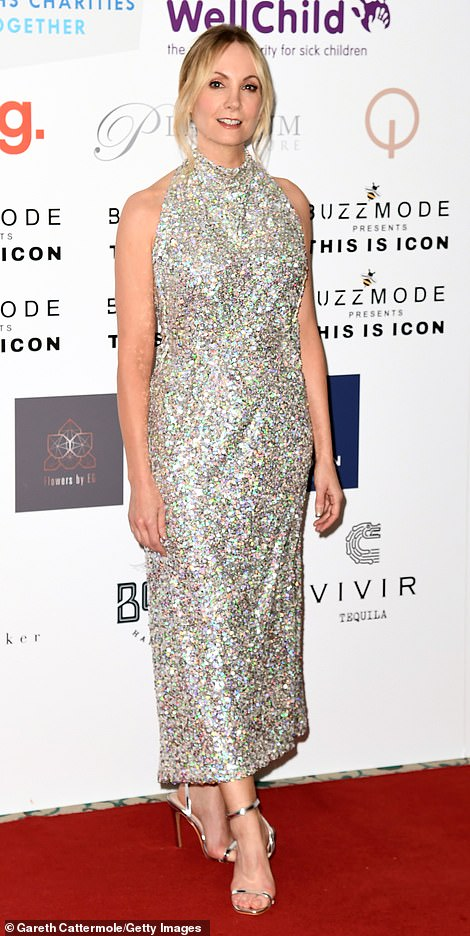 Pretty: Downton Abbey star Joanne sparkled in a silver dress and coiffed her blonde tresses into a chic up do that left a few strands loose around her face
