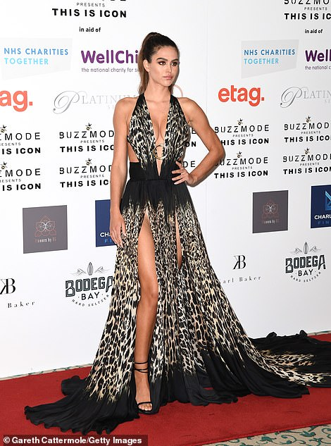 Revealing: The gown's slit-style and flowing bottom drew attention to her incredible figure
