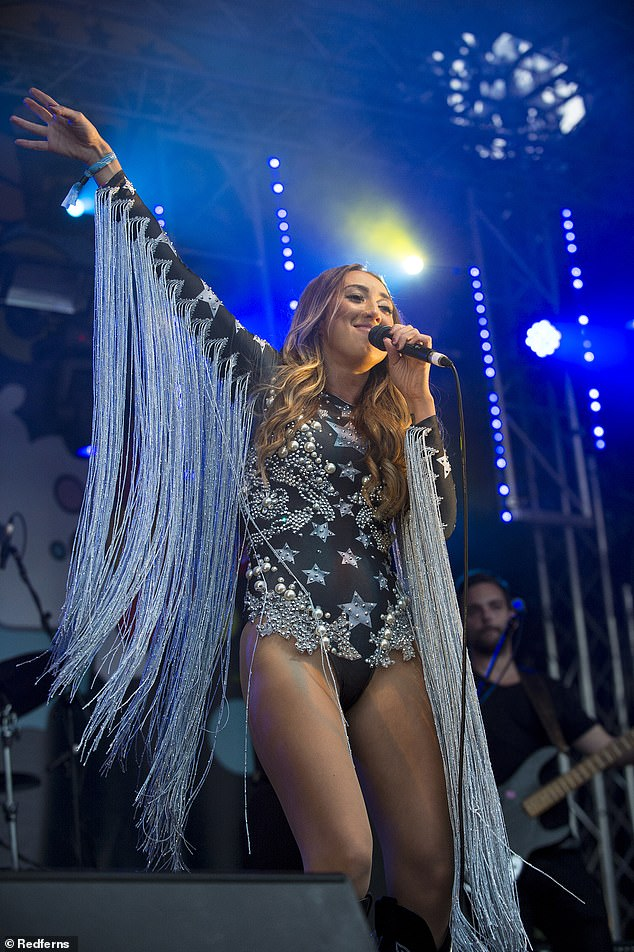 Flamboyance:Harley, 32, who is the daughter of singer and actor Martin Kemp, sparkled on stage in a bedazzled blue mini-dress with long tassels hanging down from the arms