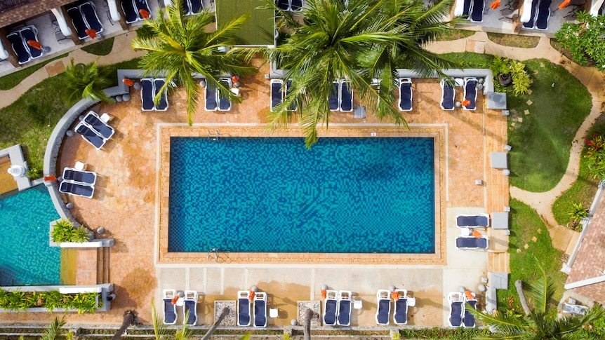 A drone shot of an empty pool at a hotel