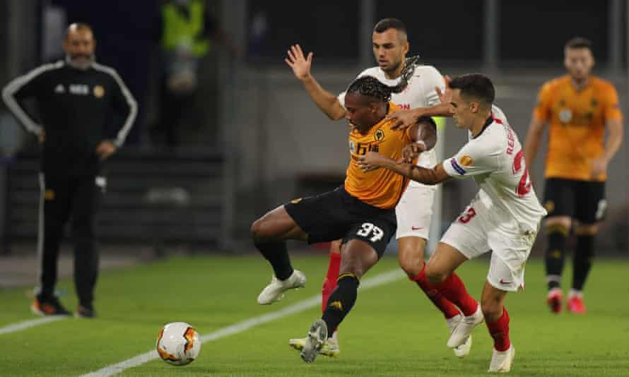 Watched by the then Wolves manager Nuno Espírito Santo, Sergio Reguilón tackles Adama Traoré during Sevilla's Europa League quarter-final in August 2020