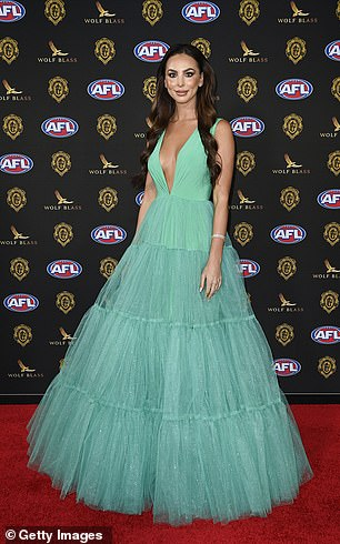 Ready for her close-up: Brittany's eye-catching gown cinched in at her slender waist and offered a hint of cleavage