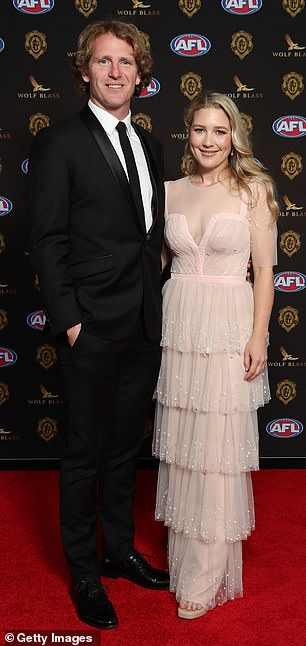 Beautiful couple: David Mundy of the Fremantle Dockers posed alongside his wife Sally Mundy