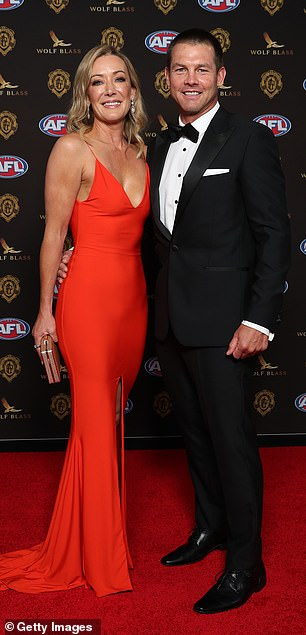 Clean-cut: In his first appearance in more than a decade, Ben Cousins, 43, looked healthy and in great spirits as he posed on the red carpet with his date Kelley Fergus