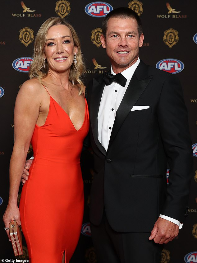 In great spirits: Ben, who won the prestigious Brownlow Medal back in 2005, donned a crisp white shirt, a tailored black suit, dress shoes and a bow tie as he beamed for the cameras