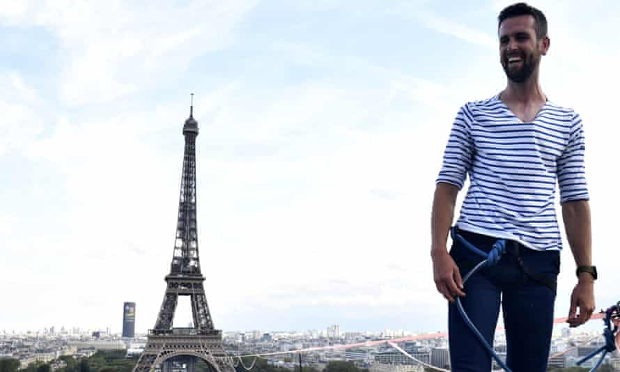 Nathan Paulin traverses a slackline between the Eiffel Tower and the Chaillot theatre in Paris, France