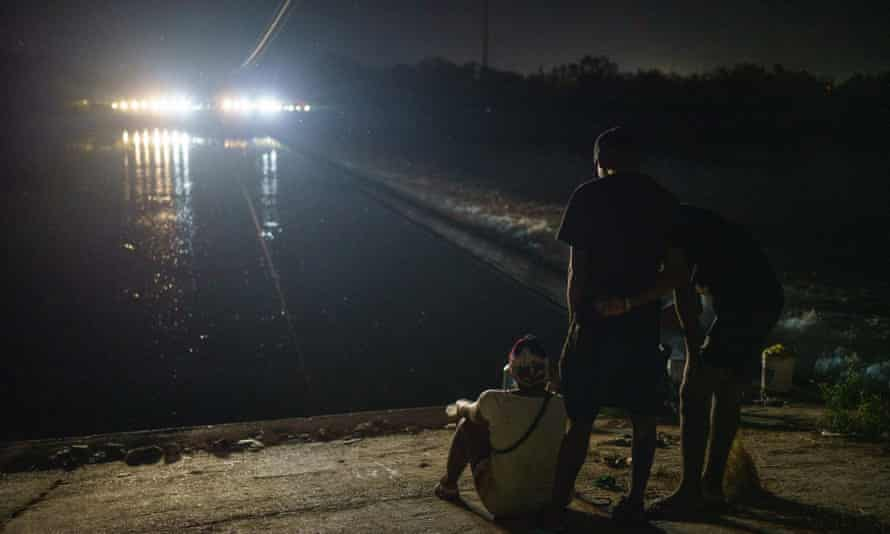 Texas state troopers block access to a dam on the Rio Grande.