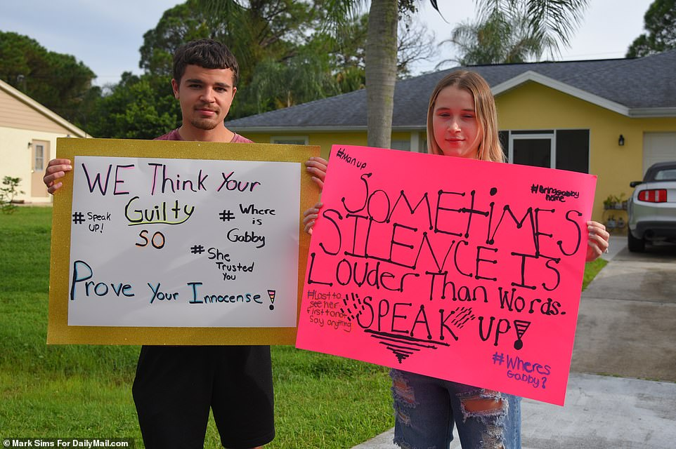 People crowded the Laundrie's front yard calling on Laundrie to 'prove your innocence'