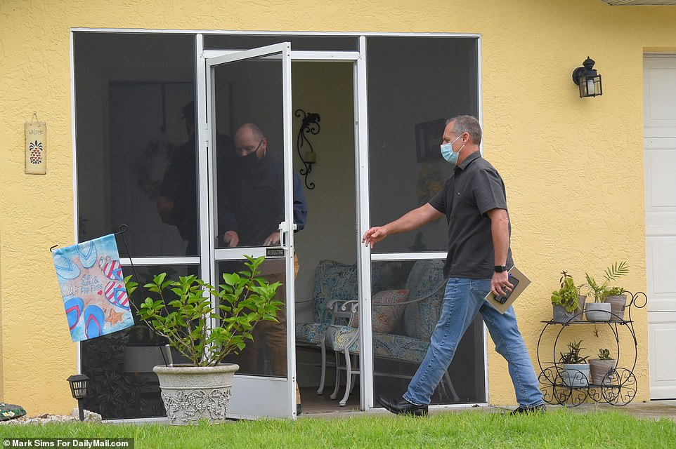 Cops arrive Friday and enter the home after Laundrie's parents informed investigators their son had vanished