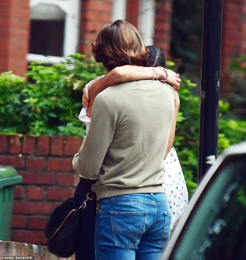 Having a moment: They were spotted hugging, with Melanie nestled into her boyfriend's shoulder at one point