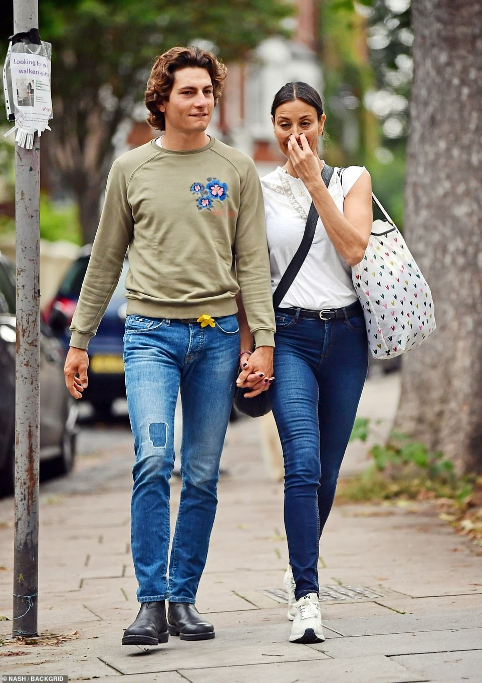 Casual: Riccardo wore jeans, an olive-hued sweatshirt which had flowers embroidered onto the chest on one side