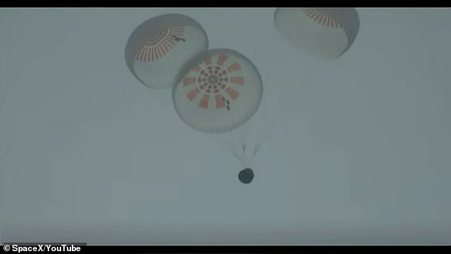 Four main chutes open as the Inspiration4 capsule descends back to earth after a three-day mission in space
