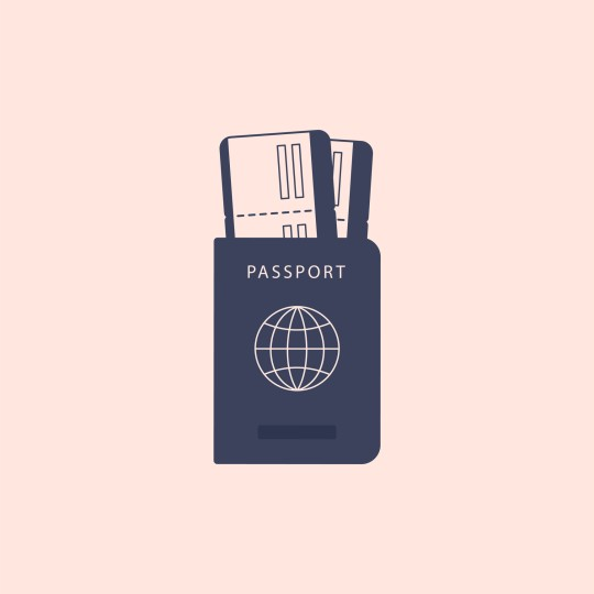 Paper passport with boarding passes inside. ID document with tickets on the plane or train isolated in the background.