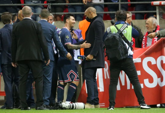 Lionel Messi chats with Thierry Henry after PSG's clash with Reims