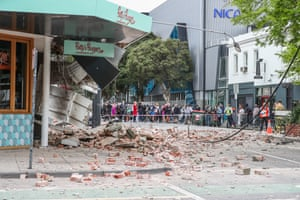 Damaged buildings following an earthquake along Chapel Street in Melbourne.