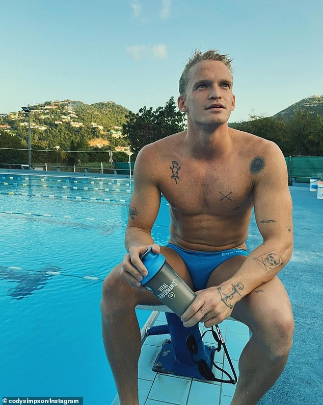 Juggle: 'Thank you to all of you for being with me. I love you and owe you everything. The next one is loading,' Cody wrote. The singer and swimmer is now training for the Paris Olympics
