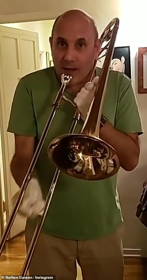 Playful side: Nathen also uploaded a video of the performer taking a playful stab at the trombone