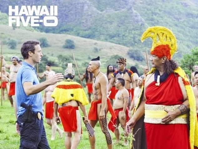Now in a costume: Al is see far right in a red and yellow native outfit with Alex far left