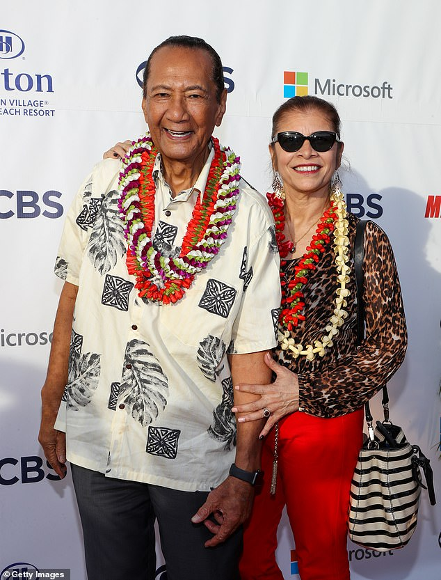 Happy man: Harrington (L) and his wife attend the Sunset On The Beach event celebrating the 10th season of Hawaii Five-0 at Queen's Surf Beach in 2019 in Waikiki, Hawaii
