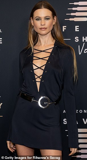Smooth: Behati's waist-length ombré hair was sleek and straight, tucked behind her ears and parted in the center