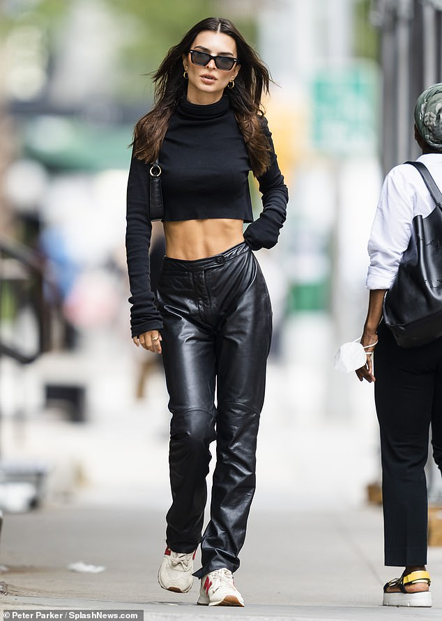 Leather lady: The model/actress/author, 30, teamed her turtleneck with leather pants
