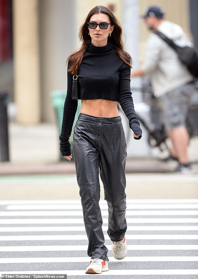 Extras:She accessorized with dark sunglasses, hoop earrings and a little black purse as well as her favorite New Balance sneakers