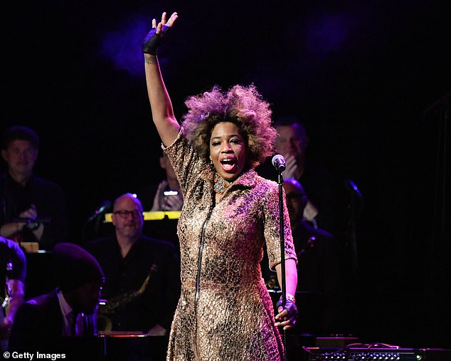 Are they correct?Many viewers are convinced the person behind the mask is American singer Macy Gray (pictured)