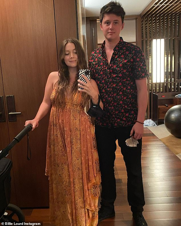 On the go:Billie glowed in a golden floral print dress as she and her love posed next to a stroller ahead of an outing