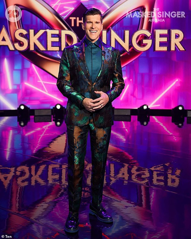 Dressed up: The Masked Singer, who always looks sharp and ready for TV in a well-tailored suit, wrote: 'Back in the day I always had the volume turned up to 11 and protecting my hearing wasn't top of mind,' referring to a work with audiology company Connect Hearing