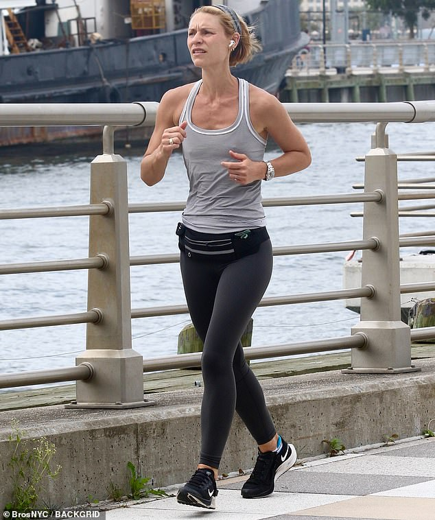 Workout chic:The actress, 42, wore charcoal leggings, a light gray tank top and a matching headband in her short, blonde hair