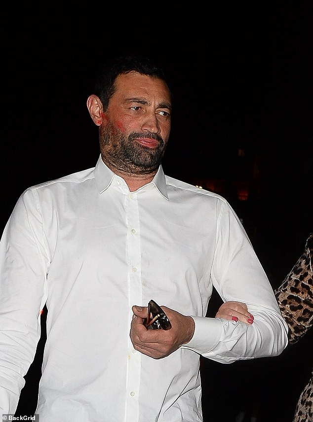 Red faced: The former TOWIE star, 40, left Rami covered in red lipstick from his ears to his cheeks after an intense PDA display during their date night