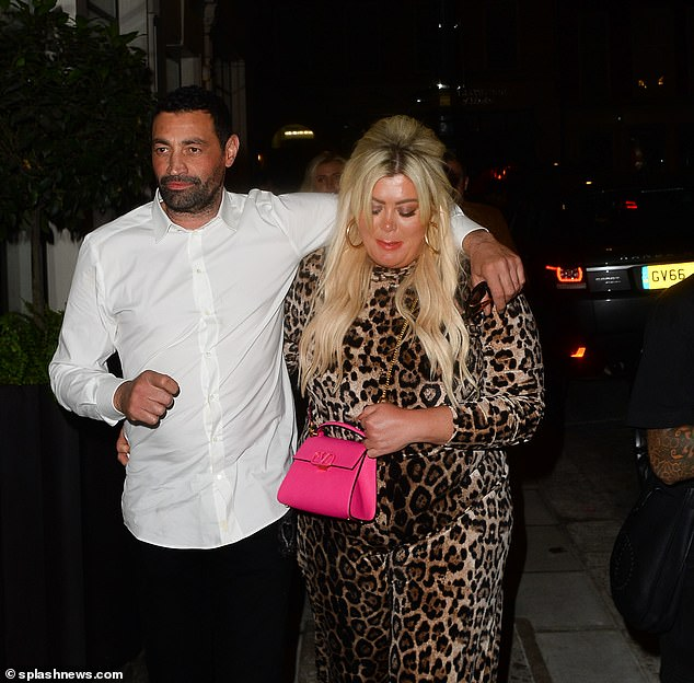 Support: The reality star looked down as she nestled under her beau's arm and headed home after the PDA-filled dinner