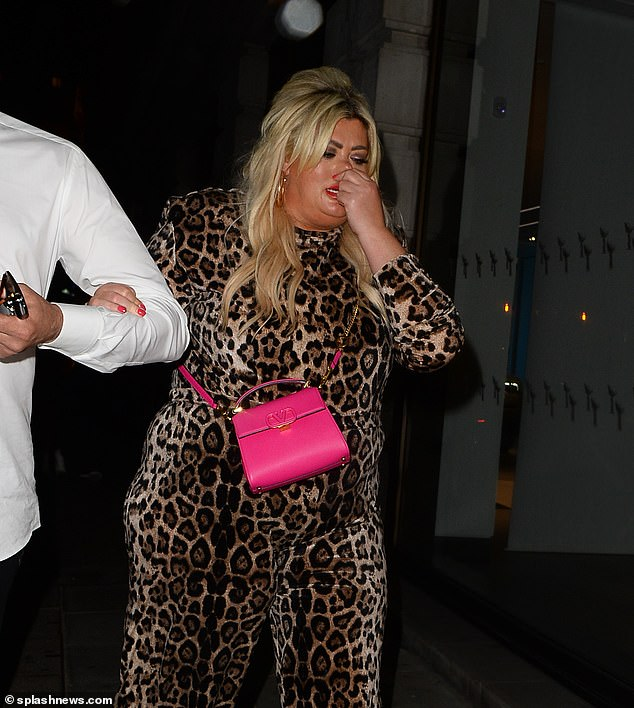 Home time: Gemma looked worse for wear as she clung onto her beau while leaving the Mayfair eatery