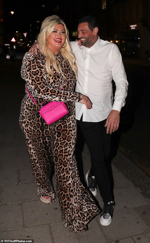 Loved-up: The former TOWIE star appeared in high spirits as she cosied up to her man and they giggled together as they left their luxurious dinner in Mayfair