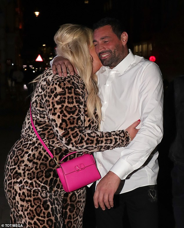 Smooch: The happy couple packed on the PDA as Gemma nestled into Rami's shoulder and kissed him on the cheek