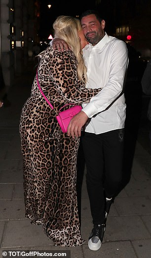 PDA: The reality star got up close and personal with her beau as they walked down the street