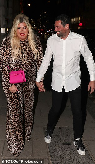 Upbeat: Gemma looked radiant as she grinned alongside her man and accessorised her animal print ensemble with an enviable hot pink Louis Vuitton bag