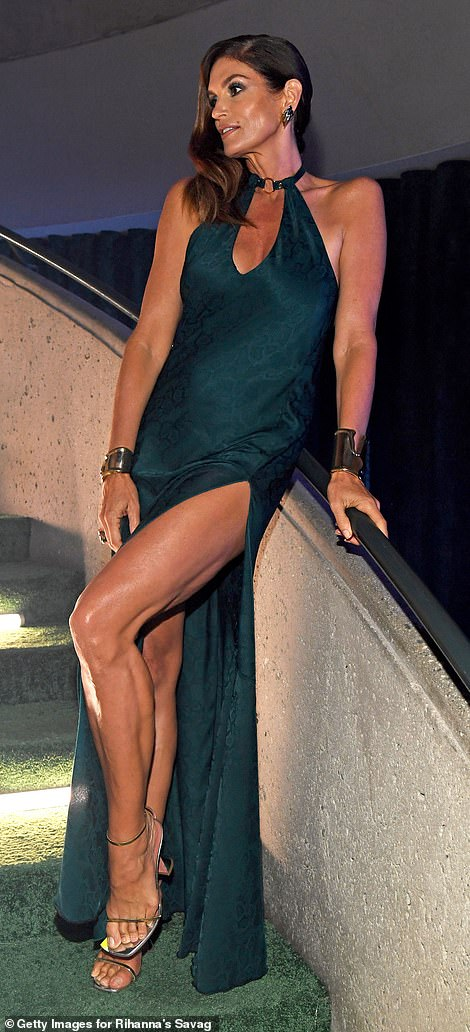 Leggy: Crawford posed with her legs crossed over one another, giving a clear view of her strappy chrome heels