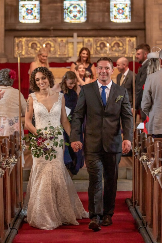The wedding of Alex Lilley and Dan Lilley who live in Harby, Nottinghamshire. They created their dream wedding with 130 guests for just ??4,000 ??? thanks to nifty tricks and DIY hacks such as using eBay and Facebook Marketplace. They also did as much DIY-style as possible and Alex even grew her own bouquet of flowers to walk down the aisle in front of their 130 guests. They held the wedding at their home on 21st August. Their reason for doing this on a budget was to save money to go towards their home renovation. See SWNS story SWOCwedding. A thrifty couple saved thousands on their DIY wedding - from buying dresses on eBay to growing their own bouquets in the back garden ??? and said they ???wouldn???t have changed a thing???. Newlyweds Alex and Dan Lilley shared how they created their dream wedding with 130 guests for just ??4,000 ??? thanks to nifty tricks and DIY hacks. The couple, from Harby in Nottinghamshire, utilised second-hand websites such as eBay and Facebook Marketplace to bring their dream wedding to life while keeping costs low. Thrifty Alex, 33, even grew her own bouquet of flowers to walk down the aisle in front of their 130 guests.