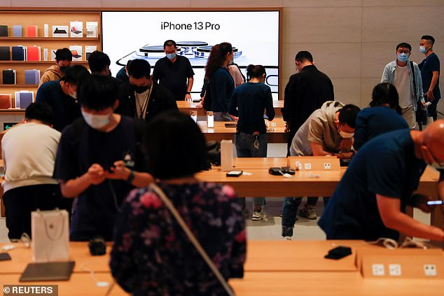 People are seen wearing face masks are at an Apple Store in Beijing, China, September 24